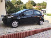 Mazda 2, Scheckheft