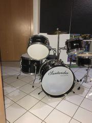 Santander Schlagzeug schwarz Hochglanz wie