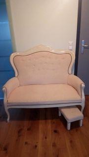 Sofa mit Schemel
