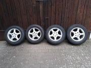 4 Alufelgen mit Bridgestone-Reifen für