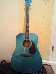 Fender Metallik blaue Gitarre