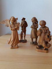 4 Holz-Schnitzfiguren