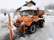 Unimog 421 mit Schneepflug Und